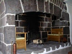 Open haard in een gite in de Auvergne